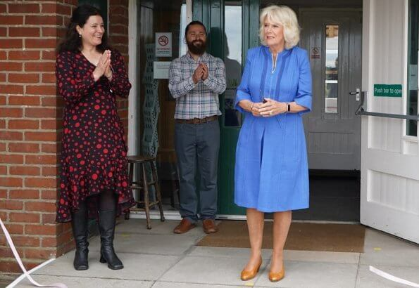 Duchess of Cornwall, Patron of Community First, visited Oxenwood Outdoor Education Centre. She wore a blue summer dress and pearl earrings