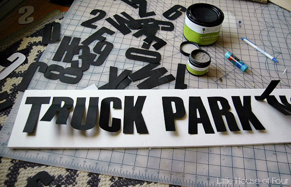 Use a straight edge and glue stick to attach letters