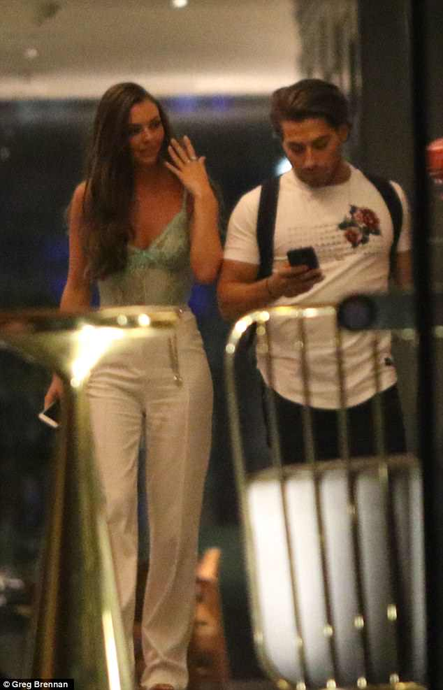 Love Island's Kendall Rae-Knight and Kem Cetinay are pictured kissing in a hotel lobby