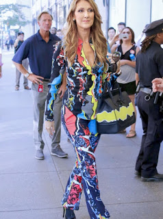 Celine Dion in a multicolored patterned Versace jumpsuit