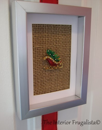 Attached an old Santa Sleigh Brooch to burlap and framed it
