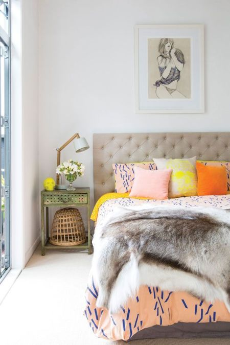 cosy grey bedroom with bright cushions