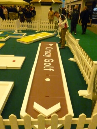 Minigolfer Richard Gottfried playing UrbanCrazy's minigolf course at the 2012 London Golf Show