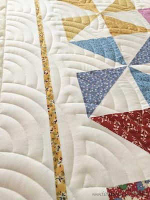 'Baptist Fan' digital pantograph on a traditional Pinwheel Quilt