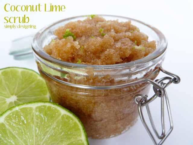 Close up of opened jar showing freshly made Coconut Lime raw sugar scrub sitting next to 2 cut limes