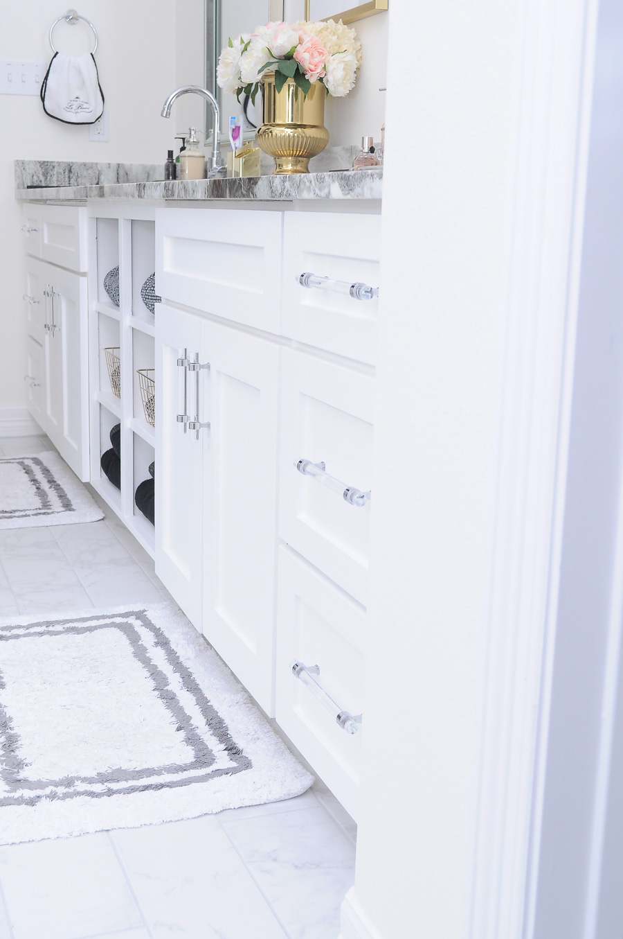 DIY tutorial on how to turn chrome and lucite cabinet pulls and hardware into a brushed satin gold finish. Perfect for bathrooms and kitchens.