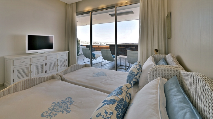 Bedroom in penthouse apartment in the desert