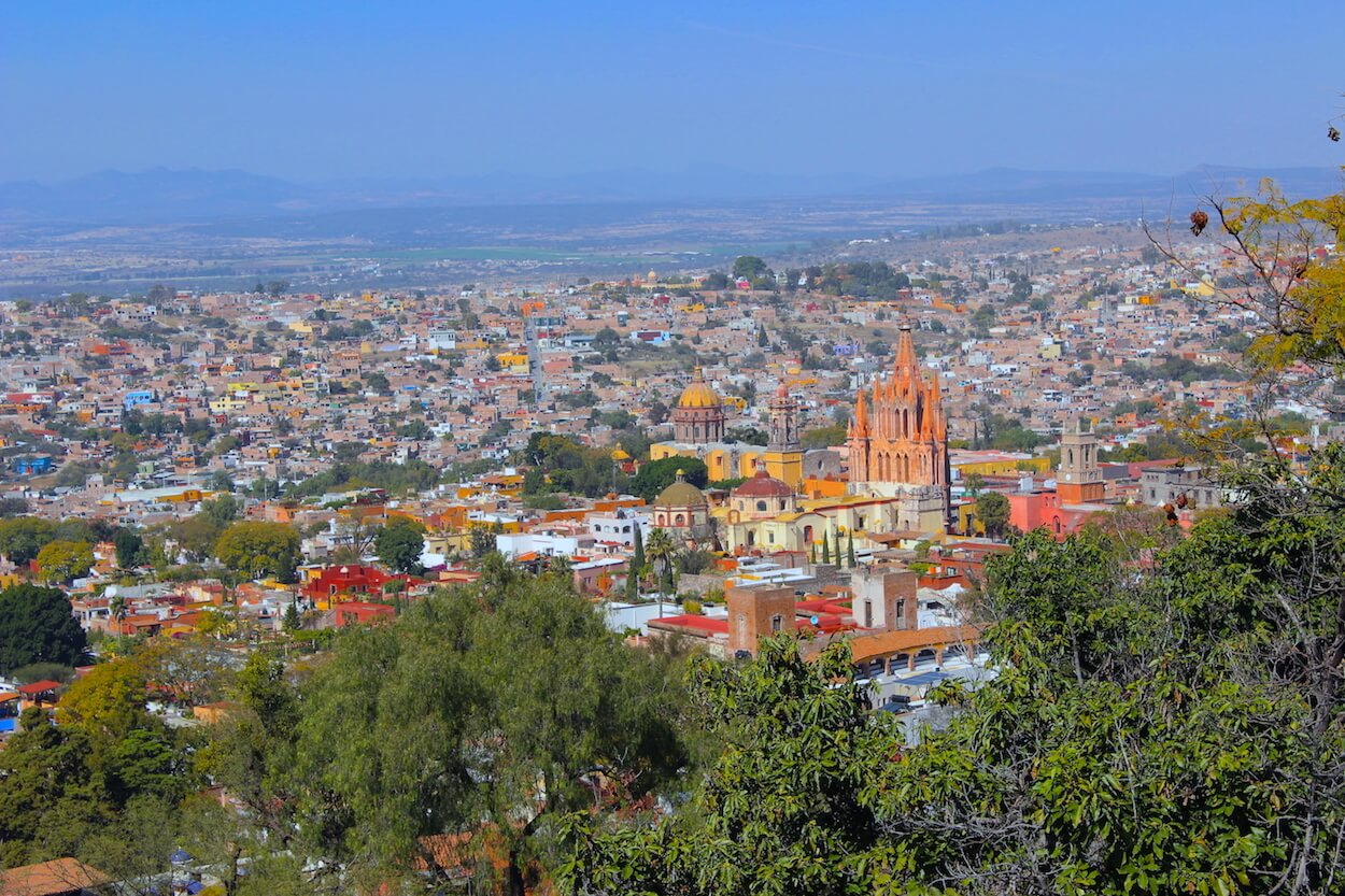 san miguel de allende panorama with pink church view