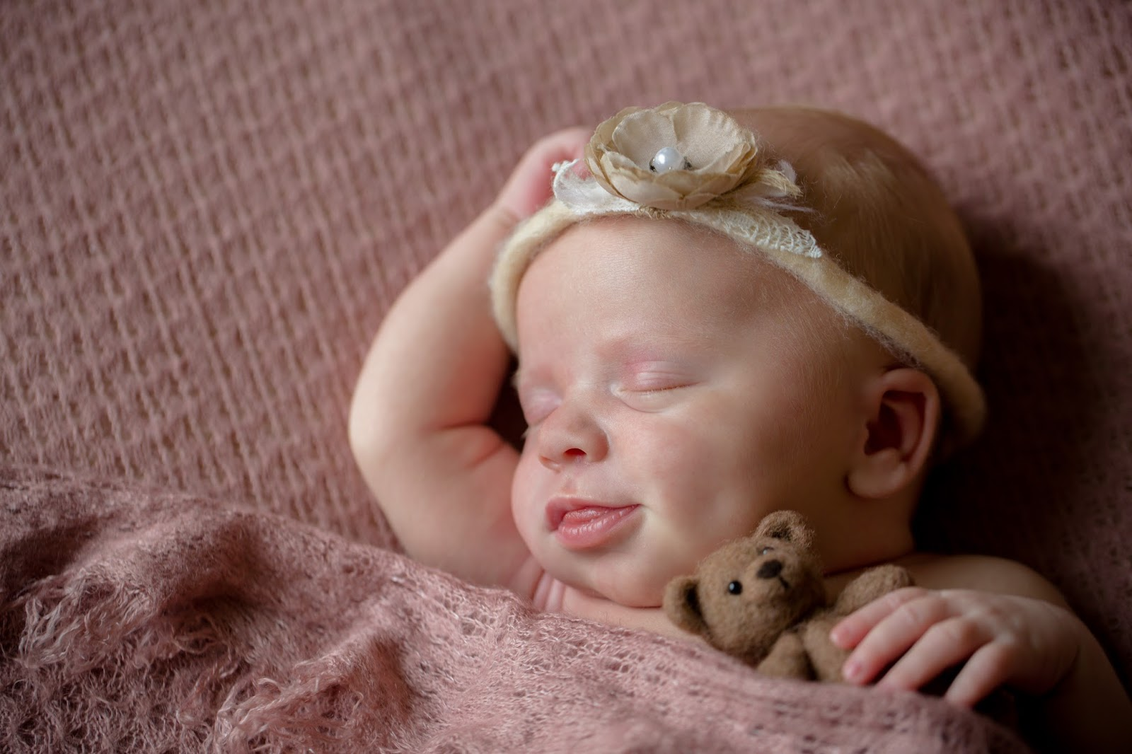 Baby with bear and flower tieback