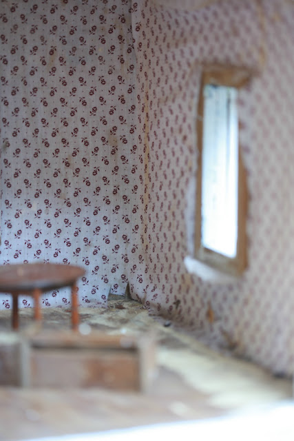 vintage doll house with wall paper