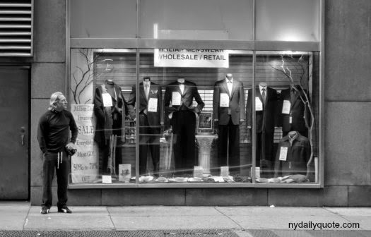 http://www.dreamstime.com/royalty-free-stock-photo-new-york-syle-man-dressed-casually-stands-next-to-window-showing-tuxedos-image33204675#res4467664