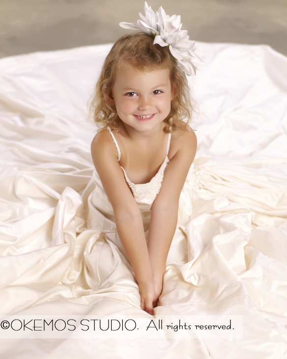 24e844551cf5 A little girl in her mother s wedding dress. Adorable.  Okemos Studio -  Lansing