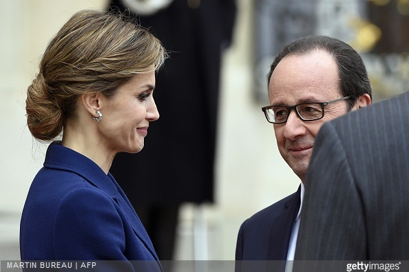 French president Francois Hollande shakes hands with Queen Letizia of Spain after a meeting at the Elysee presidential palace