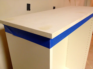 painted plywood top on kitchen cabinet