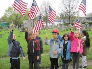 Students holding up flags