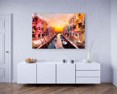 living room with a watercolor venice painting of a canal, boats, houses, sunset orange in color