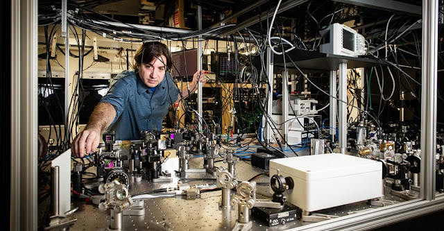 Thomas Corbitt in his lab, setting up a complex sequence of lasers. Credit: Elsa Hahne/LSU