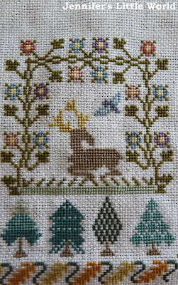 Small section of Three Things by Moira Blackburn cross stitch sampler
