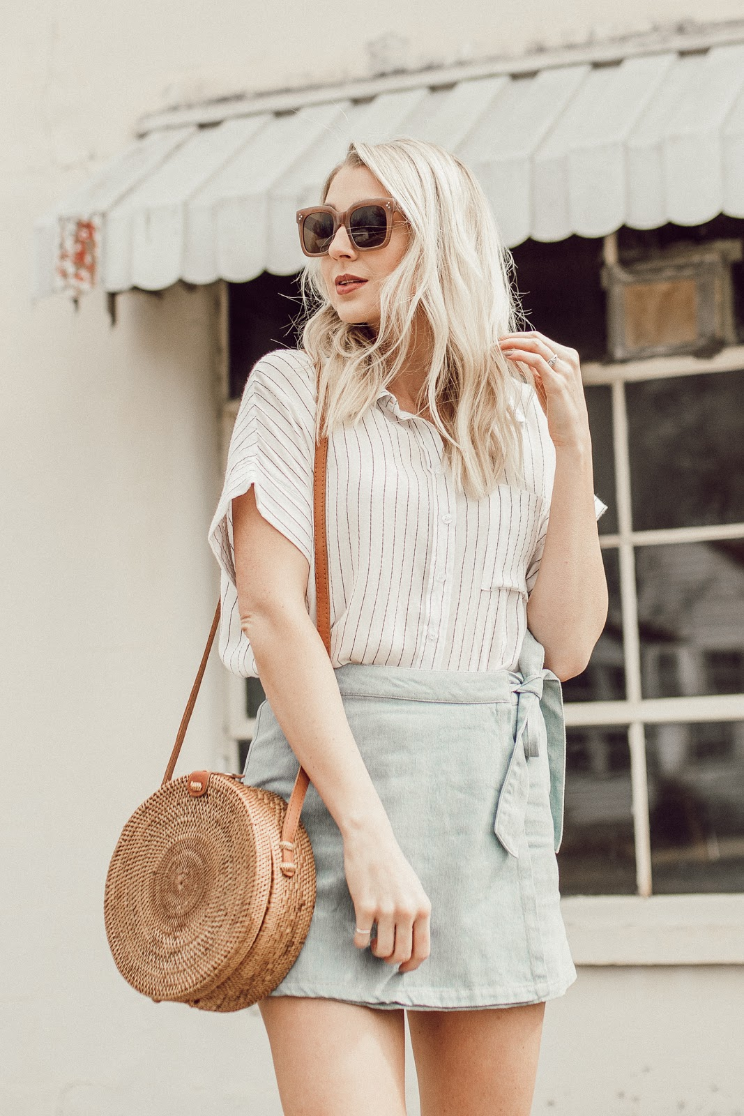outfit with a round straw bag