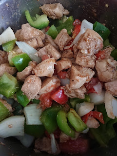 stir frying the chicken and vegetables
