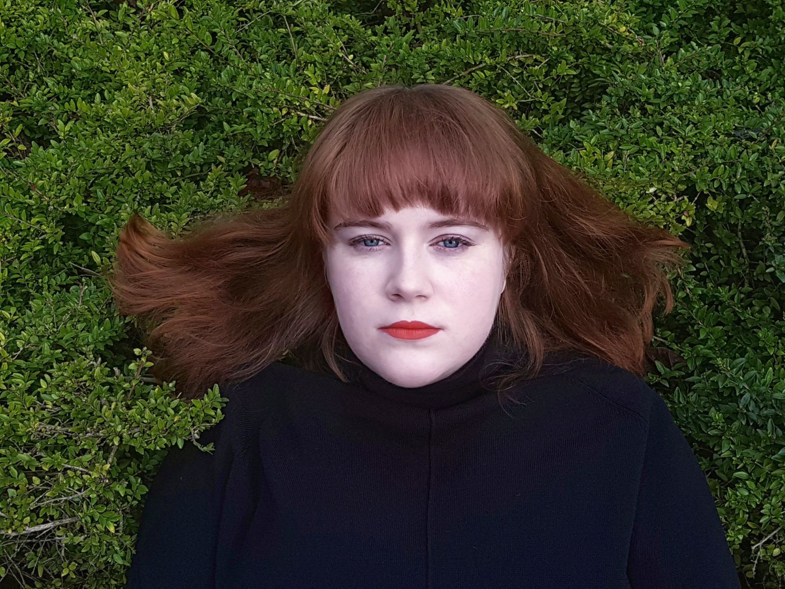 Portrait of a hella pale girl in a hedge