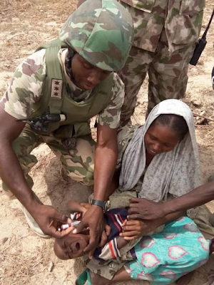 Photos of Nigerian Soilder vaccinating rescued children in the battle front