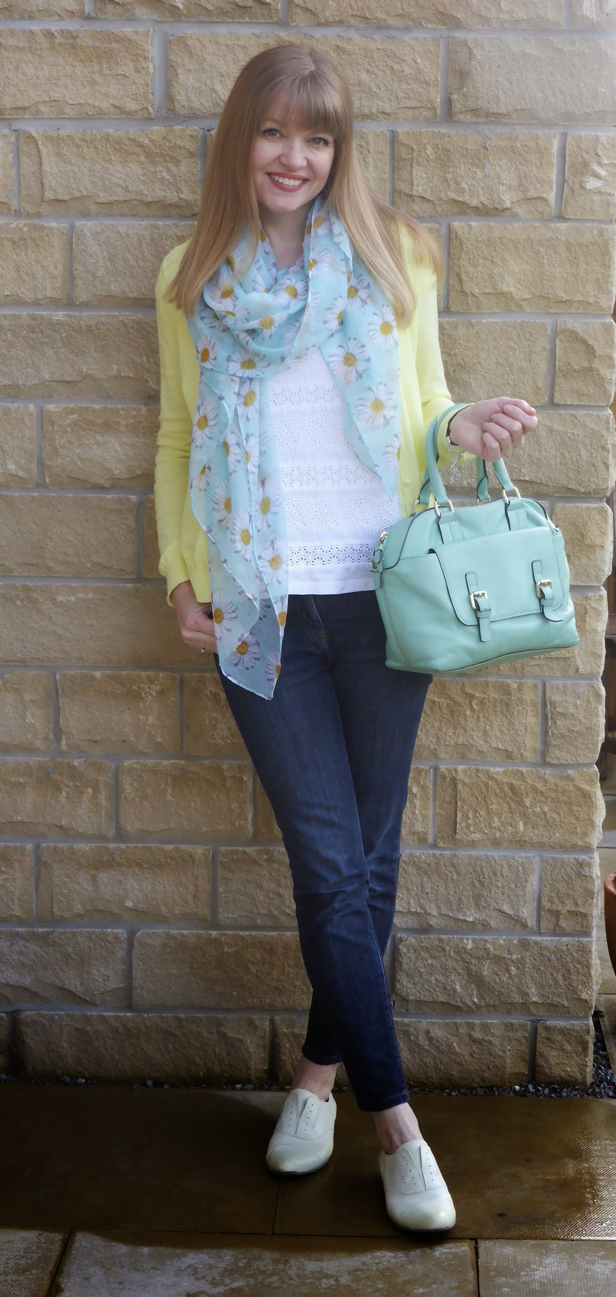 What Lizzy Loves, over 40 fashion blogger wearing white broderie tee, lemon cardigan, mint green daisy scarf, skinny jeans, yellow brogues, mint green bowling bag