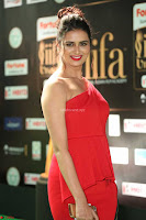 Meenakshi Dixit in Red One Shoulder Red Zipped up gown at IIFA Utsavam Awards019.JPG