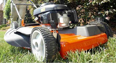 Husqvarna lawnmower cutting grass.
