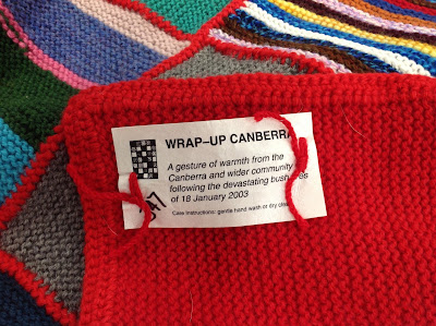 Handmade label on a Wrap Up Canberra blanket. Each blanket was disturbed with a similar label.