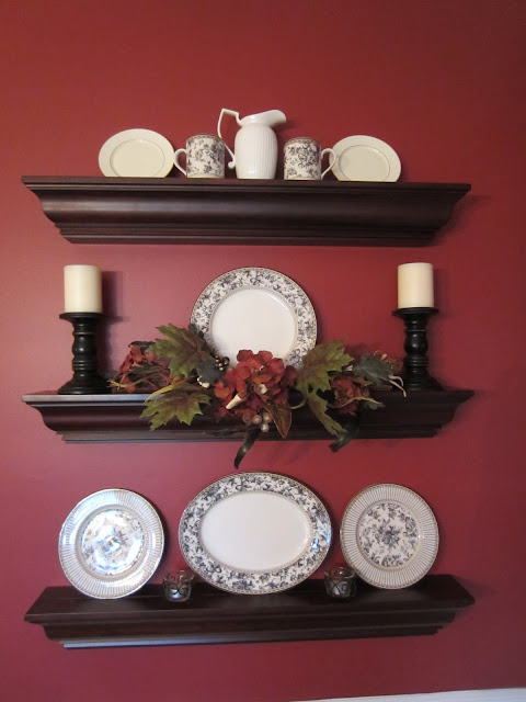 Wall Shelves in dining room decorated for fall