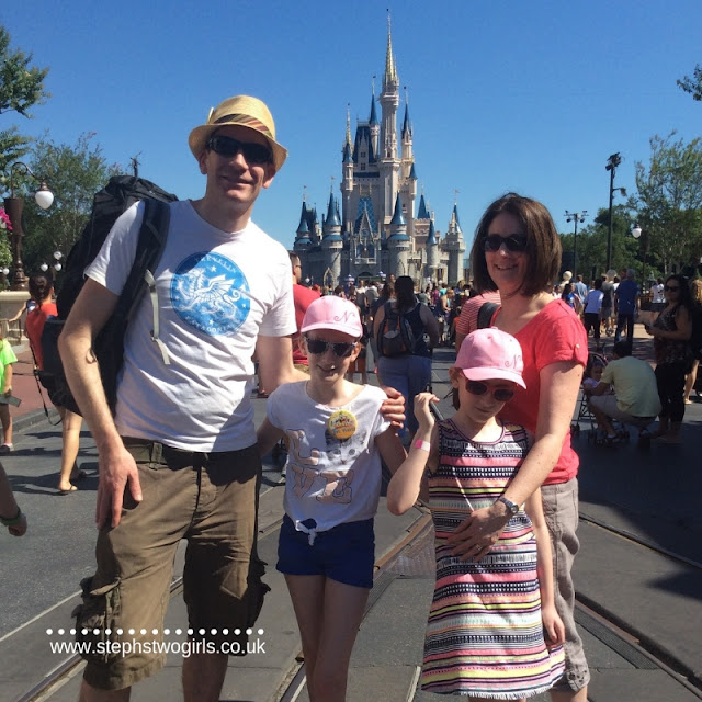 Stephs two girls family in front of magic kingdom castle