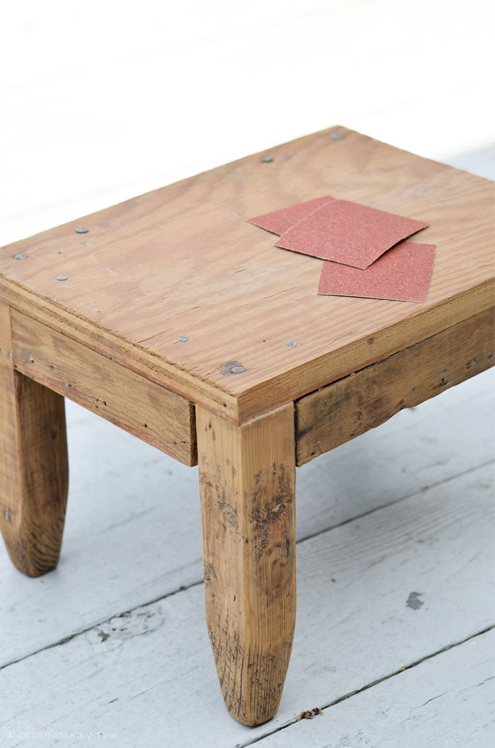 Unfinished wood footstool with sandpaper