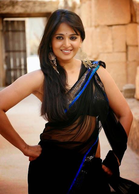 Beautiful Actress Anushka Shetty Dancing in Rain Wallpaper