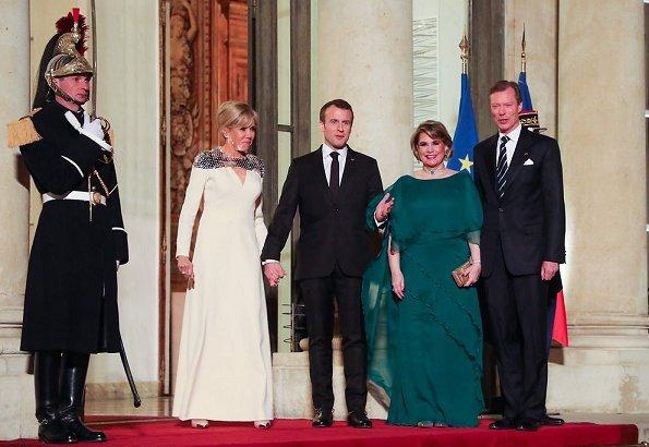 Brigitte Macron wore Louis Vuitton pumps, Duchess Maria Terasa wore Fendi fur coat and Miu Miu shoes for state dinner at Elysee Palace in Paris