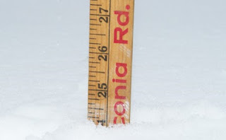 meteorolgists measuring snow ruler storm