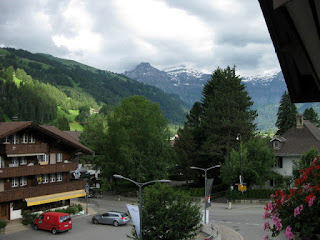 View of green hills and distant snow-streaked peak from pep's hotel room, Lenk im Simmental, Switzerland