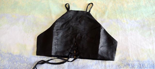 Details on Dresslink's faux suede lace-up cutout tie-waist black crop top.