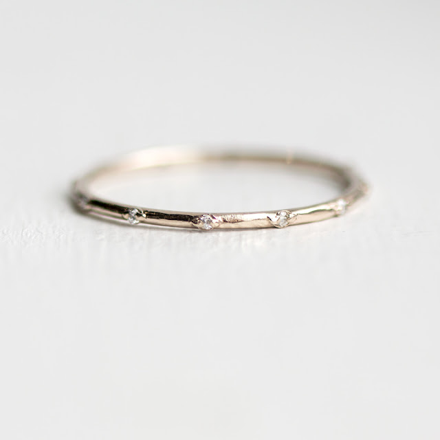 Thin 1.2mm stackable ring with tiny white diamonds in 14k white gold with a bright polish finish