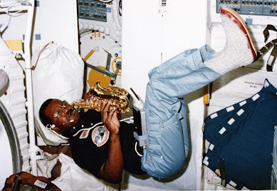 Ronald McNair playing saxophone in space