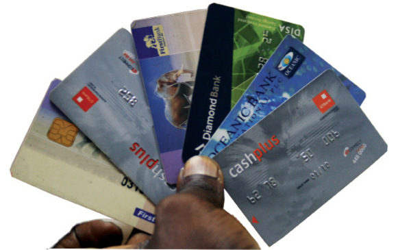 Image result for images of nigerian currency and atm cards