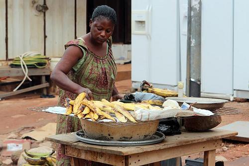 Grilling bananas in Ghana