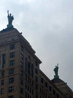 Twin Statue of Liberties atop Buildings, Buffalo, NY   180 OUT