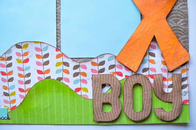 boy scrapbook page layout in orange, green, and brown with blue. Curved arrow.