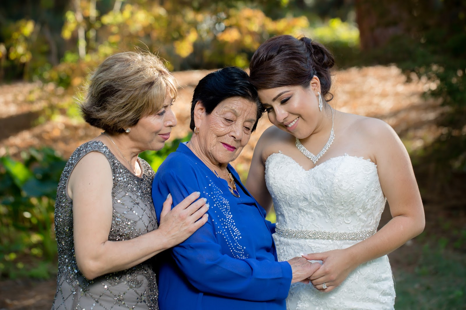 Bride, Mother of the Bride, and Grandmother of the Bride share loving embrace
