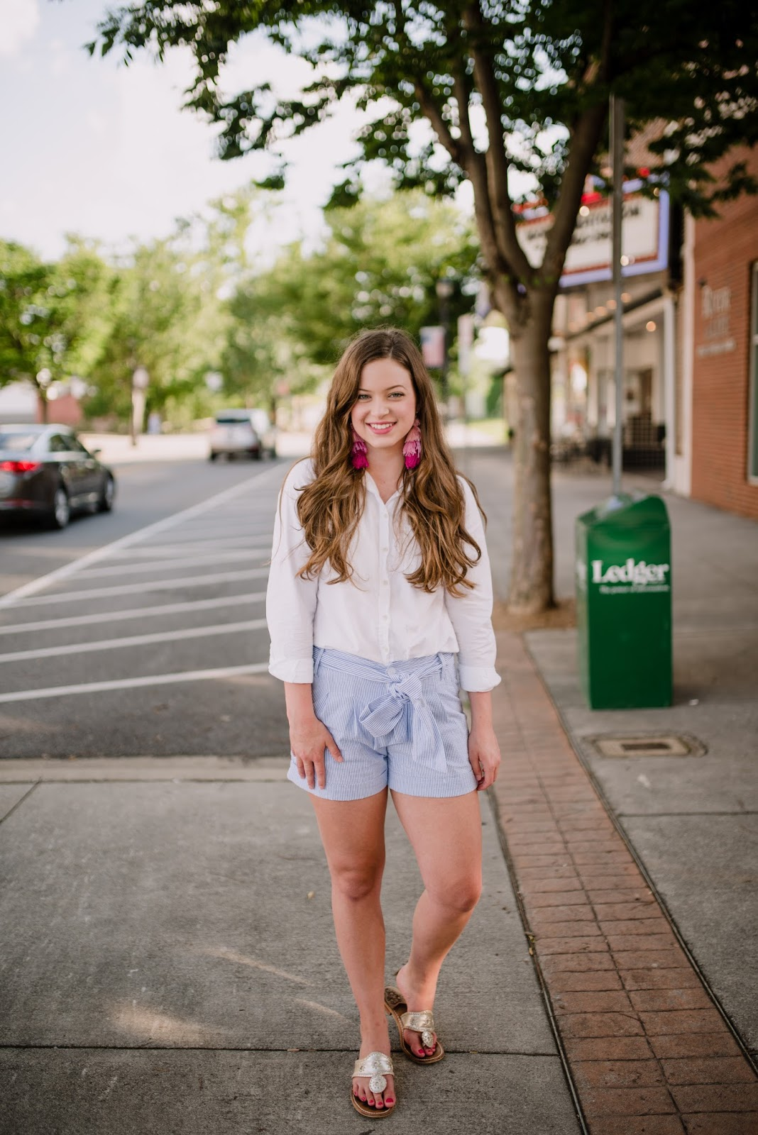 preppy summer outfit with jack rogers tassel earrings and seersucker