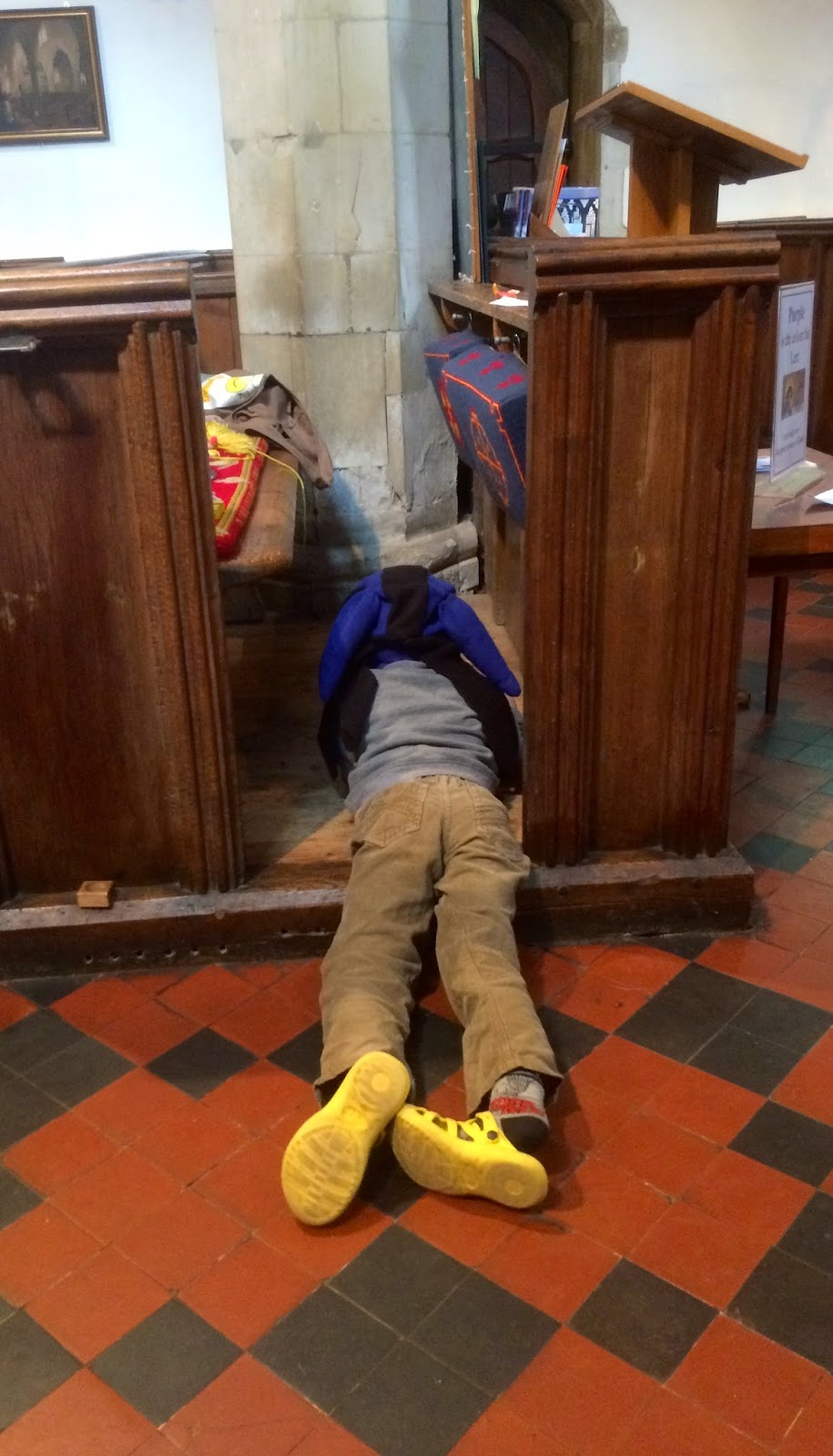 child playing in a pew