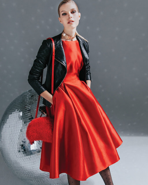 Red full-skirted dress, black leather jacket, black hose, red fur bag, from Fashionmagazing.com winter 2017 issue
