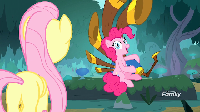 Fluttershy finds Pinkie Pie with a large 5 piped bagpipe contraption in the forest.