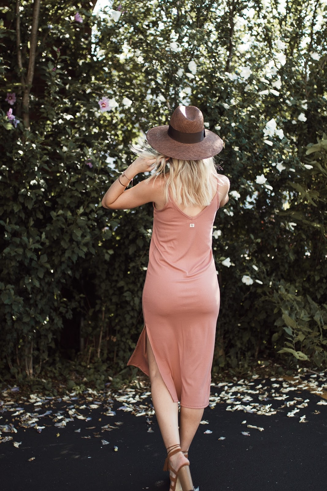 pink midi slip dress with a hat and heeled sandals